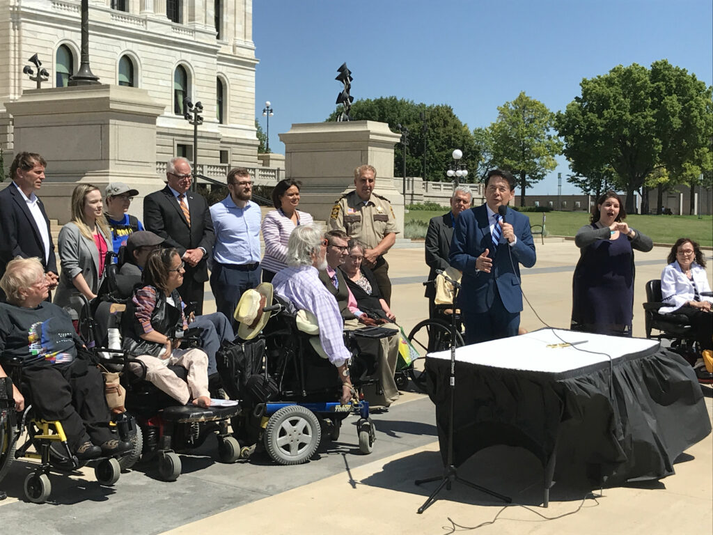 Jesse Bethke Gomez speaking in front of the Capitol